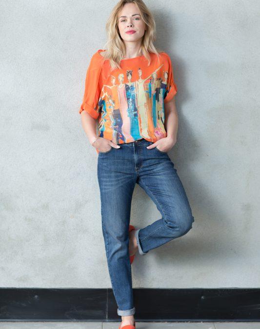 Liste over butikkene og bilde T-shirt fra Levolution med de kjære fyrstikkpikene på.